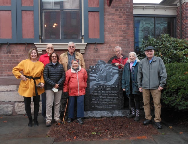 The Planning Group stood by the General Lyman L. Lemnitzer Memorial that was installed at the Wayne County Historical Society in Honesdale, the week of Oct. 26. From left, front row: Patti Bursis; Chairperson Paula Roos; Martha Sader; Roger Herman, WCHS Trustee. Back row: Nancy Carmody,  WCHS Trustee; Albert G. Rutherford; Robert Keen; Stanton Pratt,  WCHS Trustee. Absent from picture: Wendell Kay and Warren Schlosser.